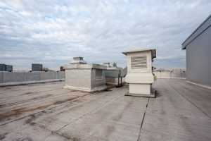 A Commercial Roofing System in Need of a Flat Roof Coating
