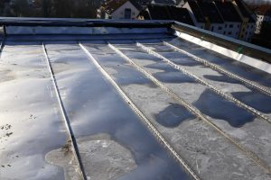 Flat Roofing System With Damaged Material