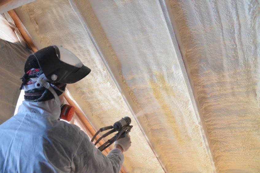 Technician Spraying Polyurethane Roof Warming Foam Coating of Roof